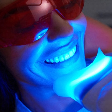 person receiving in-office teeth whitening