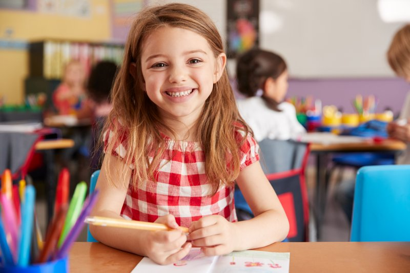 young child smiling in school